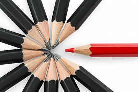 pic of pencils  - One red pencil standing out from the circle of black pencils - JPG