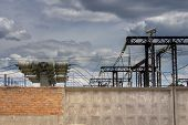 image of substation  - For high-voltage electrical substation fence of the city under the supervision of surveillance cameras