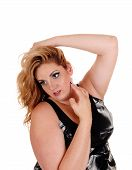 stock photo of plus size model  - A beautiful young plus size woman with blond curly hair and one hand on her head standing isolated for white background - JPG
