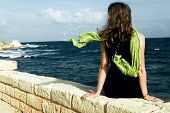 Woman With Shawl, Sitting On Wall An Looking At Sea poster