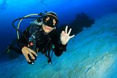 pic of cave woman  - Young woman scuba diving - JPG