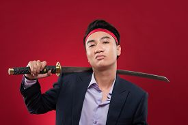 image of shoulder-blade  - Portrait of confident Vietnamese manager with katana over his shoulder - JPG