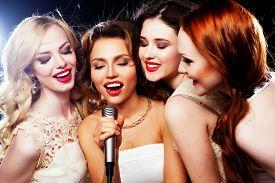 pic of karaoke  - Four beautiful stylish girls singing karaoke at the club - JPG