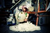 young woman in artistic studio sit on floor holding chinese lampion