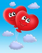 Color illustration of two heart ballons on blue sky.
