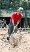 Young Boy Splitting Logs