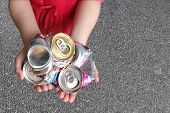 Recycling Aluminum Cans in a Child's Hands
