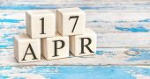 April 17Th. Wooden Cubes With Date Of 17 April  On Old Blue Wooden Background. poster