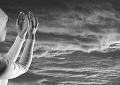 White female prayer on black sky