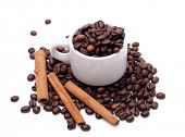 Coffee beans and Cinnamon Isolated over White Background