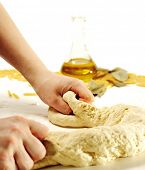Dough Preparation with Olive Oil on a Background