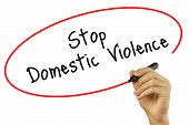 Man Hand Writing Stop Domestic Violence With Black Marker On Visual Screen. Isolated On Background. poster