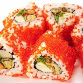 Mussel Maki Sushi - Roll made of Mussels, Tamago (japanese omelet) and Salad Leaf inside. Red Tobiko (flying fish roe) outside