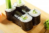 Kappamaki - Cucumber Sushi Roll Garnished with Lemon and Wasabi on the Wooden Plate