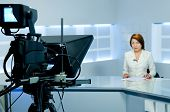 Television Anchorwoman During Live Broadcasting