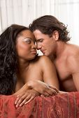 Interracial Lovers - sensual heterosexual couple making love. African-American black woman and Cauca