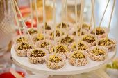 Festive Chocolate Cake Pops With Candy Sprinkles Close-up On The Table. Table With Sweets Prepared F poster