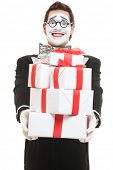 happy mime holding many boxes of presents. isolated on white background