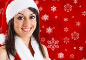 Portrait of a beautiful young girl wearing christmas clothes