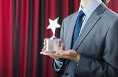 stock photo of award-winning  - Businessman awarded with star award - JPG