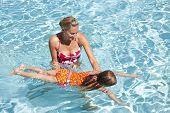 Little Girl learning to swim