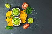 Guacamole And Nachos With Ingredients On The Background Of A Black Stone Board. Top View, Copy Space poster