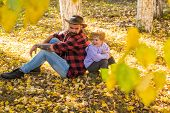 Father And Son Camping. Little Boy With His Father In Autumn Outdoors.happy Joyful Father With A Cut poster