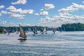 Feluccas Sailing Along The Nile River At Aswan - Egypt poster