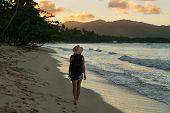 Traveler Girl Walking On A Beach In Tropical Nature. Young Girl Traveler Walking In Nature. Traveler poster