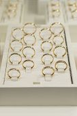 Golden Rings Store. Wedding Gold Rings On The Showcase. Wedding Ring Set. Toned. Vertical Photo poster