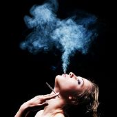 woman smokes in the dark