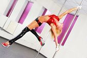 stock photo of pole dancer  - beautiful dancer on the pole - JPG