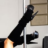 stock photo of flogger  - dancer on the pole - JPG