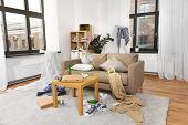 mess, disorder and interior concept - view of messy home living room with scattered stuff poster