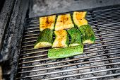 Grilling Zucchini Or Courgette On A Coal Barbecue Grill. poster