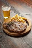 porterhouse with french fry and beer