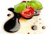 tomato and basil over balsamic vinegar