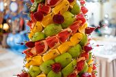 Tropical Fruits Cut Thtower Of Chopped Tropical Fruits And Strawberries At The Banquet. Appetizer At poster