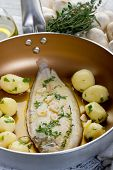 sole fish with potatoes over casserole