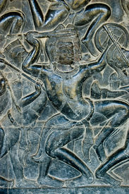 image of mahabharata  - Bas relief sculpture of a Kaurava soldier fighting in the  Battle of Kurukshetra against the Pandava - JPG