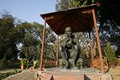 stock photo of mahatma gandhi  - gandhi statue at rajghat memorial in new delhi india - JPG