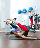 Aerobics pilates women with magic ring and crosstrainer