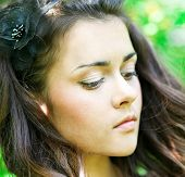 Portrait of beautiful gorgeous young pretty woman relaxing and yearning in spring park, eyes down, l