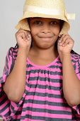 picture of cornrow  - Young black child silly with hat with a grey background - JPG