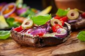 stock photo of portobello mushroom  - Giant Portobello mushrooms stuffed with mozzarella and tomatoes - JPG