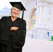 Senior Woman In Graduate Gown, Outdoors