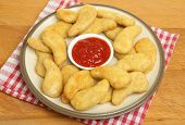 Chicken dippers or nuggets with tomato ketchup.