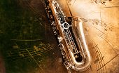 foto of sax  - Retro Sax with old yellowed texture background - JPG