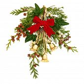 Christmas decorative spray of mistletoe, ivy, cedar leaf sprigs with pine cones and golden bells tie