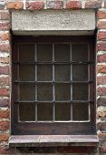 Small Antique Window In A Red Brick Wall poster